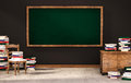 Classroom, Green Blackboard On Black Wall With Table, Chair And Piles Of Books On Concrete Floor, 3d Rendered Stock Photos - 68368843