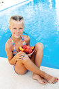 Little Cute Girl Sitting Beside The Pool Royalty Free Stock Photos - 68382568