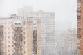 Urban Houses And Snowfall In City In Winter Stock Images - 68395524