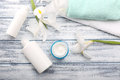 Cosmetic Cream In Glass Jar With Towels And Beautiful Flowers On Royalty Free Stock Photo - 68400275