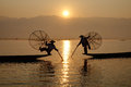 Fisherman Of Inle Lake In Action When Fishing Stock Photos - 68405233