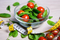 Diet And Weight Loss Concept - Salad With Spinach And Tomatoes A Royalty Free Stock Photography - 68430477
