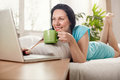 Beautiful Young Woman Lying In Bed With Cup Of Coffee Stock Images - 68437214
