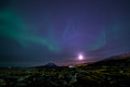 Moon Shining And The Northern Lights, Nearby Nuuk, Greenland Royalty Free Stock Photo - 68441675