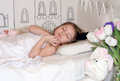 A Peaceful Photo Of A Sleeping Little Girl With A Crown On Her Head Stock Photography - 68464152