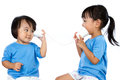 Asian Little Chinese Girls Playing With Paper Cups Royalty Free Stock Image - 68469376