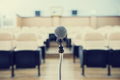 Before A Conference, The Microphones In Front Of Empty Chairs. Royalty Free Stock Photography - 68476757