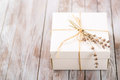 White Present Box With Rustic Twine And Sprig Of Lavender Stock Image - 68485481
