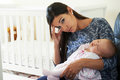 Tired Mother Suffering From Post Natal Depression Royalty Free Stock Images - 68488749