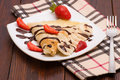 Crepes With Banana And Strawberries Royalty Free Stock Photos - 68510978