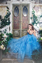 Beautiful Young Woman In Gorgeous Blue Long Dress Like Cinderella With Perfect Make-up And Hair Style Stock Photo - 68513570