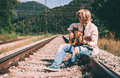 Young Man With Guitar Sitting On The Railway Stock Photography - 68547032
