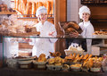 Bakery Staff Offering Bread Stock Photo - 68550030