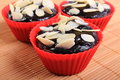 Fresh Baked Chocolate Muffins With Sliced Almonds Stock Photos - 68556363