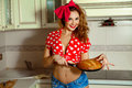 Attractive Young Housewife With Curly Hair In Pinup Style Posing Stock Photos - 68562133