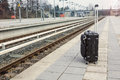 Black Suitcase On Platform At A Trainstation Royalty Free Stock Image - 68565886