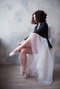 Young Ballerina Or Dancer Girl Putting On Her Ballet Shoes Royalty Free Stock Image - 68568336