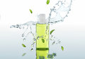 The Herbal  Moisturizing Shampoo Stands On The Water Background With Splashes And Mint Leaves Stock Images - 68574184