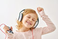 Happy Girl Dancing While Listening To Music Royalty Free Stock Images - 68604119