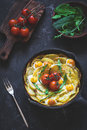 Frittata With Potatoes, Spinach, Tomatoes And Cheese Royalty Free Stock Images - 68605969