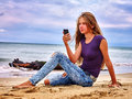 Girl On Sand Near Sea Call Help By Phone. Stock Images - 68615464