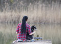 Girl With Dog On The Dock Stock Photos - 68616533