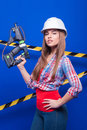 Girl Builder In The Construction Helmet And Goggles With A Construction Tool On A Blue Background Royalty Free Stock Photos - 68633758