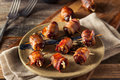 Homemade Bacon Wrapped Dates Royalty Free Stock Photo - 68654525
