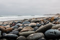 Stones Scattered Over Beach At Carlsbad State Beach Stock Photography - 68667942