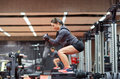 Woman Doing Squats On Platform In Gym Royalty Free Stock Image - 68688116