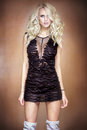 Blonde Woman In Black Mini Dress. Stock Photo - 68711100