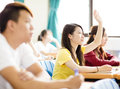 College Student Raise Hand For Question In Classroom Royalty Free Stock Photography - 68713597