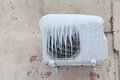 Air Conditioner With Frozen Ice And Icicles. Cooling, Cold Concept Image. Aged Wall Background. Royalty Free Stock Images - 68733599