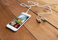 Close Up Of Smartphone And Earphones On Wood Royalty Free Stock Photos - 68744588