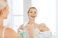 Woman With Toothbrush Cleaning Teeth At Bathroom Royalty Free Stock Image - 68745556