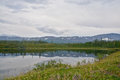 Mountains On The Shores Of Lake. Stock Image - 68750101