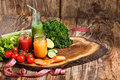 The Bottles With Fresh Vegetable Juices On Wooden Table Royalty Free Stock Photography - 68775877