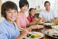 Family Eating A Meal,mealtime Together Royalty Free Stock Photo - 6881095