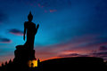 The Posture Of Walking Buddhist Statue In Twilight Silhouette Royalty Free Stock Photo - 68804625