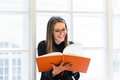 Beautiful Happy Student Girl In Glasses Reading Book On The Windowsill Stock Image - 68816871