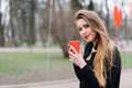 Portrait Of Young Beautiful Stylish Girl Drinking Coffee In The Park Stock Photo - 68817310