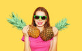 Fashion Portrait Pretty Smiling Woman And Two Pineapple In Sunglasses Over Yellow Stock Photo - 68857290