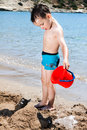 Little Boy In Blue Sea Royalty Free Stock Photo - 68893275