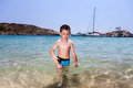 Little Boy In Blue Sea Royalty Free Stock Photo - 68893375