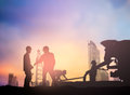 Silhouette Engineer Working  In A Building Site Over Blurred Con Royalty Free Stock Image - 68903706