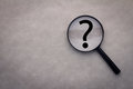 Magnifying Glass And A Question Mark On The Leather Royalty Free Stock Images - 68916859