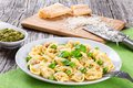 Tortellini With Green Peas, Pine Nuts, Parmesan Cheese And Grater Stock Photos - 68917153