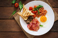 English Breakfast - Fried Egg, Beans, Tomatoes, Mushrooms, Bacon And Toast. Royalty Free Stock Image - 68917636