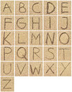 Alphabet Drawing Or Writing In The Sand Royalty Free Stock Photography - 68929537