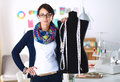 Smiling Fashion Designer Standing Near Mannequin In Office Royalty Free Stock Photo - 68936685